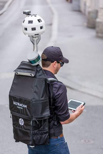 Backpack camera with operator