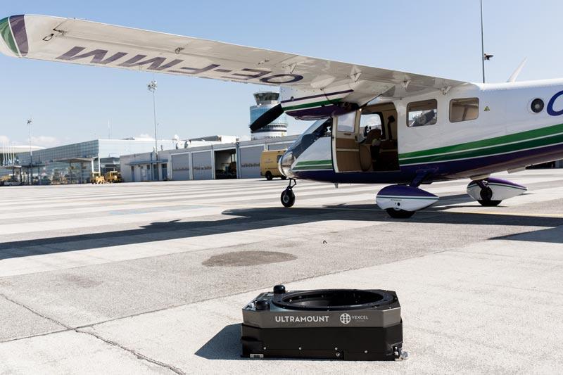 Vexcel operator preparing an UltraMount before aircraft installation